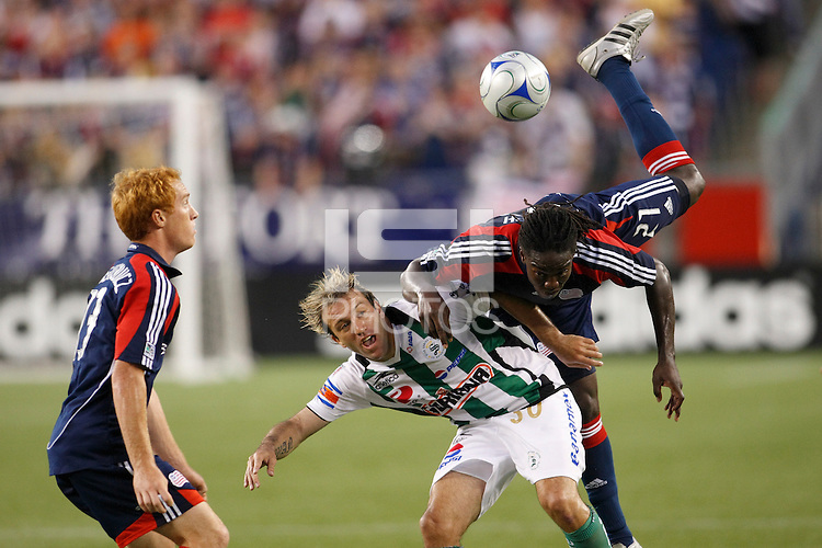 New England Revolution midfielder Shalrie Joseph (21) goes over the top of Santos Laguna forward Vicente Matias Vuoso (30) while going for a header. The New England Revolution defeated Santos Laguna 1-0 during a Group B match of the 2008 North American SuperLiga at Gillette Stadium in Foxborough, Massachusetts, on July 13, 2008.