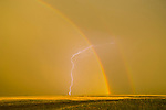 Rainbow with secondary bow, clearing thunderstorm, lightning on the Great Plains of Colorado.