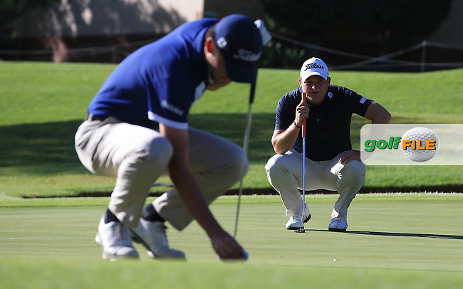 Getting ready to begin again, Renato Paratore (ITA) and Zander Lombard (RSA) mark their balls on the 9th green, before the recommencement of Round Three of the 2016 BMW SA Open hosted by City of Ekurhuleni, played at the Glendower Golf Club, Gauteng, Johannesburg, South Africa.  10/01/2016. Picture: Golffile | David Lloyd<br /> <br /> All photos usage must carry mandatory copyright credit (&copy; Golffile | David Lloyd)