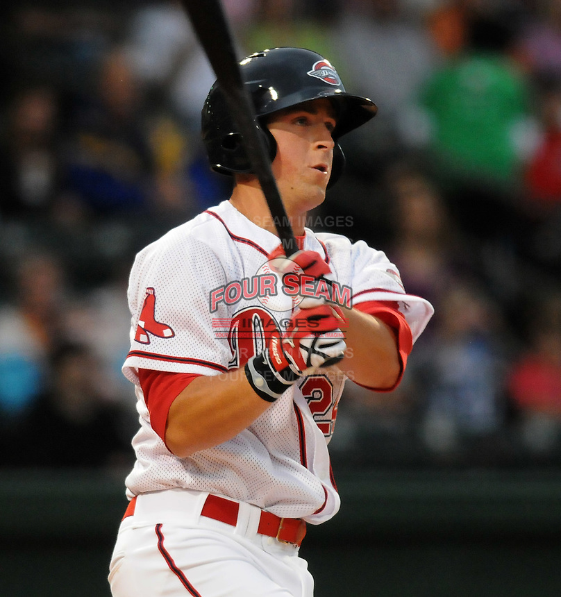 First baseman Chris McGuiness (24) of the Greenville Drive gets the first hit of the season in a game against the Delmarva Shorebirds on Opening Day, April 8, 2010, at Fluor Field at the West End in Greenville, S.C. Photo by: Tom Priddy/Four Seam Images