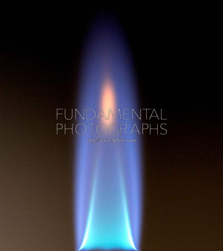 AIR INTAKE AFFECTS BUNSEN BURNER FLAME<br /> (2 of 3)<br /> Structure Of Ethylene Flame With Reduced Aeration<br /> With less air mixed into the gas the flame cools at the interconal region, turning red.