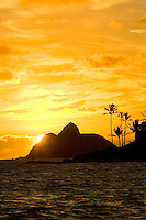A sunrise breaks the shoulder of Moku Nui to awaken the residents of Kailua.