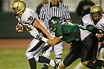Torrance, CA 10/06/11 - Tommy Webster (Peninsula #49) and Justin Concetti (South Torrance #7) in action during the Peninsula vs South Varsity football game.