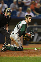 Fort Wayne TinCaps catcher Ryan Miller (20) checks the runner after blocking a pitch in the dirt during a game against the Lake County Captains on August 21, 2014 at Classic Park in Eastlake, Ohio.  Lake County defeated Fort Wayne 7-8.  (Mike Janes/Four Seam Images)