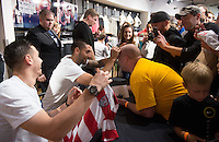 Seattle, Washington - Sunday, June 9, 2013: USMNT fan festival event at Niketown. Clint Dempsey signs a fans forehead.