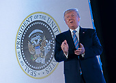 United States President Donald J. Trump arrives to speak, with an altered presidential seal behind him, at Turning Point USA's Teen Student Action Summit 2019 in Washington, DC on July 23, 2019. <br /> Credit: Chris Kleponis / Pool via CNP