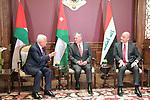 Palestinian President Mahmoud Abbas (L), Jordanian King Abdullah II (C) and Iraqi President Barham Salih (R) meet in Amman, Jordan on May 23, 2019. Photo by Thaer Ganaim