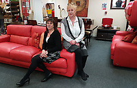 Pictured L-R: Store managers Carmela Sandal and Caroline Hopkins at the British Heart Foundation charity shop in Swansea, Wales, UK. Wednesday 12 April 2017<br /> Re: A mystery Swansea woman has donated £16,000 worth of furniture to a charity shop.<br /> The British Heart Foundation shop in Kingsway in Swansea has benefitted from the haul.<br /> Some of the furniture is so new, that similar items are still for sale with the original retailer; Furniture Village.<br /> The haul includes a side board, a display cabinet, two two-seater sofas, a three seater sofa and dining table complete with six chairs.<br /> The dining table is listed online with Furniture Village for £1,865, the display cabinet for £1,865, and a pair of the six dining chairs for £1065.<br /> The British Heart Foundation will be selling the items for probably around a quarter of the original value.