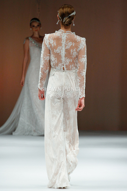Model walks runway in a bridal gown from the Victoria Kyriakides collection, during the Designer Spotlight Spring 2014 fashion show at New York International Bridal Week on October 13, 2013.