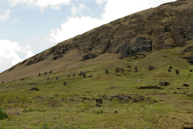 Chile, Easter Island: Sculptures at the quarry Rano Raraku where all the large sculptures were carved..Photo #: ch254-32694.Photo copyright Lee Foster www.fostertravel.com lee@fostertravel.com 510-549-2202