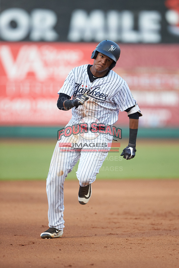 Carlos Tatis (68) of the Pulaski Yankees hustles towards third base against the Princeton Rays at Calfee Park on July 14, 2018 in Pulaski, Virginia. The Rays defeated the Yankees 13-1.  (Brian Westerholt/Four Seam Images)