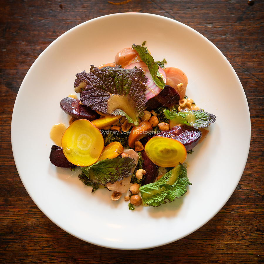 Melbourne, May 6, 2018 - A dish of roasted beetroots, hazelnut and mustard leaf at Gertrude Street Enoteca, Fitztroy, Australia. Photo Sydney Low