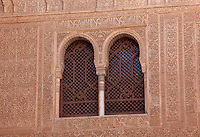 Latticed window in a stucco facade in the Patio of the Gilded Room, between the Mexuar and the Gilded Room or Cuarto Dorado in the Comares Palace, Alhambra Palace, Granada, Andalusia, Southern Spain. It was built under Mohammed V in the 14th century. The Alhambra was begun in the 11th century as a castle, and in the 13th and 14th centuries served as the royal palace of the Nasrid sultans. The huge complex contains the Alcazaba, Nasrid palaces, gardens and Generalife. Granada was listed as a UNESCO World Heritage Site in 1984. Picture by Manuel Cohen