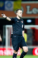 Referee, Stuart Attwell signals in favour of the home team during the Sky Bet Championship match between Brentford and Leeds United at Griffin Park, London, England on 4 November 2017. Photo by Carlton Myrie.