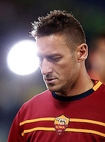 Calcio, Serie A: Roma vs Milan. Roma, stadio Olimpico, 25 aprile 2014.<br /> AS Roma forward Francesco Totti warms up prior to the start of the Italian Serie A football match between AS Roma and AC Milan at Rome's Olympic stadium, 25 April 2014.<br /> UPDATE IMAGES PRESS/Isabella Bonotto