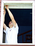 WATERBURY CT. 17 May 2019-051719SV04-Chris Aceves, 17, of Meriden Southington installs a window with Tonnotti Windows at a home in Waterbury Friday. The students from Wilcox Tech. are part of an apprenticeship program.<br /> Steven Valenti Republican-American