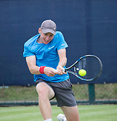 June 11th 2017, Nottingham, England; ATP Aegon Nottingham Open Tennis Tournament day 2;  Barnaby Smith of Great Britain gets down low to  two handed backhand