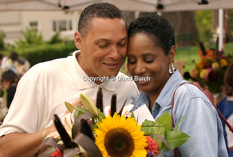 mature african american couple at flower market