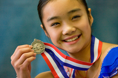 Nina Jiang shows off her second place medal that she won when she competed in the Ladies Freestyle in the 2009 Midwestern Sectional Championships at the Sugar Land Ice & Sports Center in Sugar Land. (Friday, Nov. 14, 2008, in Sugar Land. ( Steve Campbell / Houston Chronicle)
