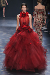 Model Pauline walks runway in a red to black ombré tulle ball gown with halter neck, laser-cut organza flowers, and tiered ombré tulle skirt, from the Marchesa Fall 2016 collection by Georgina Chapman and Keren Craig, presented at NYFW: The Shows Fall 2016, during New York Fashion Week Fall 2016.