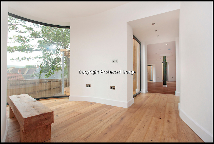 BNPS.co.uk (01202) 558833<br /> Picture: ChestertonHumberts/BNPS<br /> <br /> ****Please use full byline****<br /> <br /> A stunning house that has been built around five ancient oak trees has gone on the market for £700,000.<br /> <br /> The contemporary property has been built to look like three separate cabins that are nestled in the heart of a quiet forest.<br /> <br /> Each of the pods have their own beautiful verandas which are constructed around enormous trees that measure around 60ft tall.<br /> <br /> The cabins may appear to be individual woodland retreats but they are actually joined up by glass walkways to create one large, sprawling home.<br /> <br /> The house, which has been dubbed The Lodge, has four bedrooms, four bathrooms, a dressing room, and an open-plan kitchen, diner, and sitting room.<br /> <br /> The eco-friendly property has been built with stainless steel gutters that collect rain to water the trees and has an air source heating unit.<br /> <br /> The building, located in Beaminster, Dorset, backs on to landscaped gardens and a wildlife walk area.
