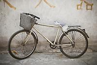 Bicycle parked along wall, Shanghai, China