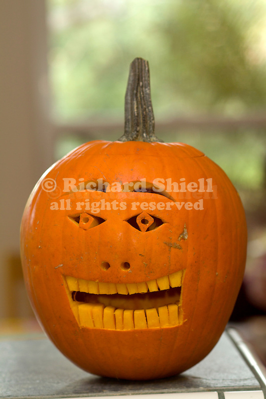 PUMPKIN CARVED INTO JACK-O-LANTERN