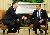 United States President Barack Obama shakes hands with President Mikheil Saakashvili of Georgia after a bilateral meeting in the Oval Office of the White House, January 30, 2012, Washington, DC. The two leaders discussed Georgia's contributions to security in Afghanistan as well as mutual cooperation in trade, tourism, energy, science and culture.  .Credit: Mike Theiler / Pool via CNP