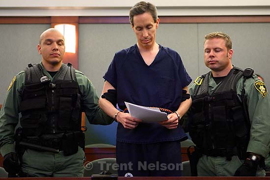 Handcuffed and flanked by Las Vegas Metro PD Swat officers, FLDS leader Warren Jeffs appeared before Judge James M. Bixler in the Clark County Regional Justice Center this morning and waived an extradition hearing, agreeing to be returned to Utah to face charges related to allegedly arranging an underage marriage. ; 8.31.2006<br />