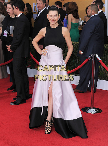 Julianna Margulies.Arrivals at the 19th Annual Screen Actors Guild Awards at the Shrine Auditorium in Los Angeles, California, USA..27th January 2013.SAG SAGs full length black white sleeveless pink skirt slit split strappy sandals hand on hip .CAP/DVS.©DVS/Capital Pictures.