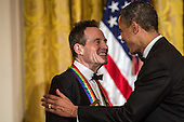 United States President Barack Obama shakes hands with John Paul Jones of the band Led Zeppelin after giving remarks at the Kennedy Center Honors reception at the White House on December 2, 2012 in Washington, DC. The Kennedy Center Honors recognized seven individuals - Buddy Guy, Dustin Hoffman, David Letterman, Natalia Makarova, John Paul Jones, Jimmy Page, and Robert Plant - for their lifetime contributions to American culture through the performing arts. .Credit: Brendan Hoffman / Pool via CNP