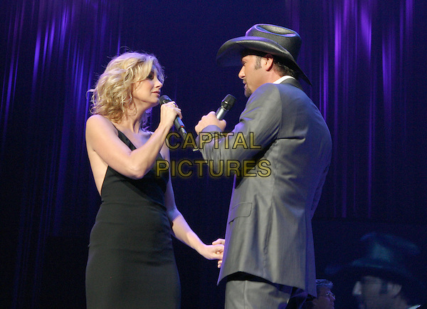FAITH HILL & TIM McGRAW.The 9th Annual Agassi Grand Slam for Children..Photo: Kevin Ferguson/2004.October 2nd, 2004.half length, concert, stage, live, gig, singing, grey, gray suit, hat, black dress.www.capitalpictures.com.sales@capitalpictures.com.©Kevin Ferguson/AdMedia/Capital Pictures