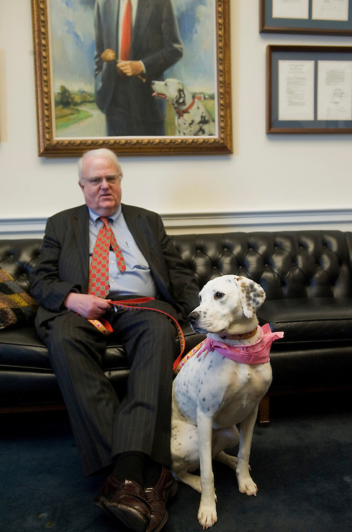 UNITED STATES - APRIL 07:  Rep. Jim Sensenbrenner, R-Wisc., is pictured with Monique, an dog adopted from a shelter, in his Rayburn office.  (Photo By Tom Williams/Roll Call)