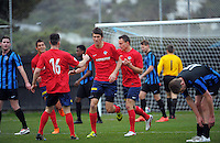 Action from the Central League football match between Miramar Rangers (blue and black) and Western Suburbs (red and white) at David Farrington Park, Wellington, New Zealand on Saturday, 1 August 2015. Photo: Dave Lintott / lintottphoto.co.nz