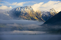 Caribou Mountains peaking through the early morning mist in British Columbia, Canada