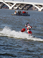 As part of a Washington, D.C. holiday tradition, Santa, along with his elves and reindeer, put on a water show on the banks of the Potomac River in National Harbor on Saturday, Dec. 24, 2011, in Oxon Hill, Md.