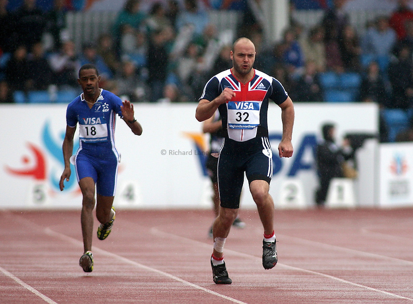 Photo: Paul Thomas..VISA Paralympic World Cup 2007. Athletics. 13/05/2007. .Huges Quiatol of France (18) and Lloyd Upsdell of Great Britain (32) in the men's T35 200m.