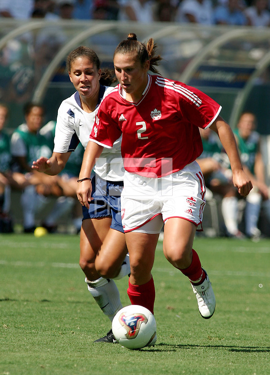 Shannon Boxx, left, Christine Latham, right, USA vs. Canada at the Third Place Match of the FIFA Women's World Cup USA 2003. USA 3, Canada, 1. (October 11, 2003). .