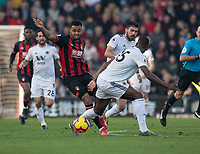 Bournemouth's Joshua King (left) under pressure from Wolverhampton Wanderers' Willy Boly (right) <br /> <br /> Photographer David Horton/CameraSport<br /> <br /> The Premier League - Bournemouth v Wolverhampton Wanderers - Saturday 23 February 2019 - Vitality Stadium - Bournemouth<br /> <br /> World Copyright © 2019 CameraSport. All rights reserved. 43 Linden Ave. Countesthorpe. Leicester. England. LE8 5PG - Tel: +44 (0) 116 277 4147 - admin@camerasport.com - www.camerasport.com
