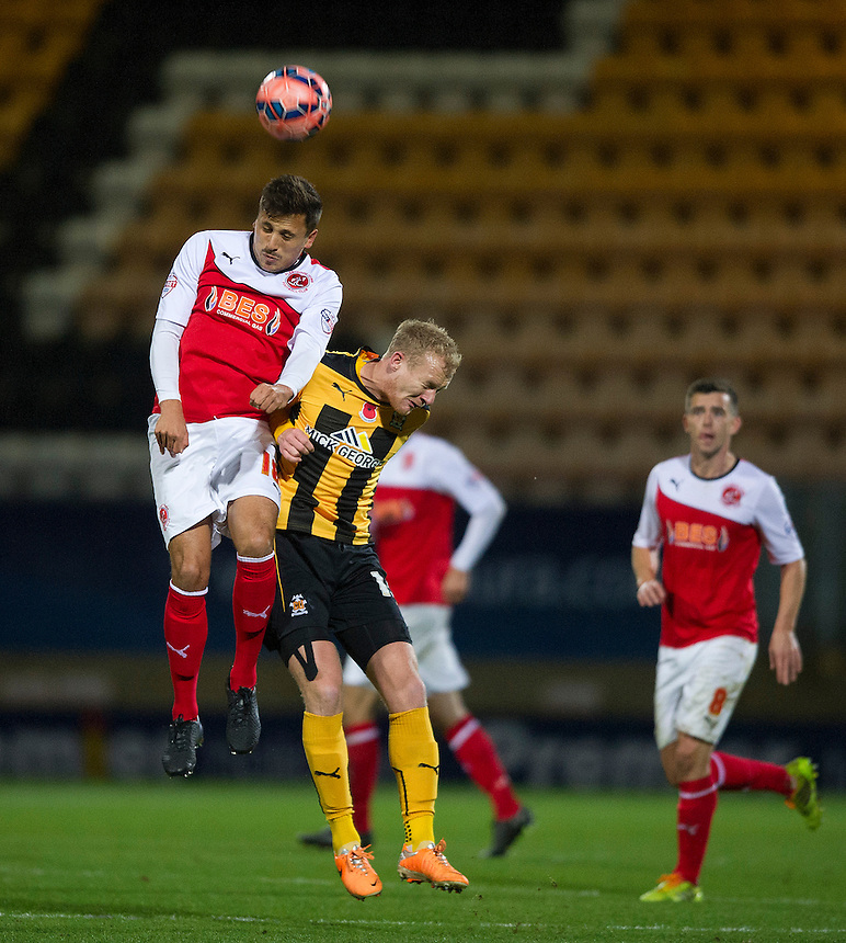 Fleetwood Town's Antoni Sarcevic wins the ball against Cambridge United's Robbie Simpson<br /> <br /> Photographer Stephen White/CameraSport<br /> <br /> Football - FA Challenge Cup First Round - Cambridge United v Fleetwood Town - Saturday 8th November 2014 - R Costings Abbey Stadium - Cambridge<br /> <br />  &copy; CameraSport - 43 Linden Ave. Countesthorpe. Leicester. England. LE8 5PG - Tel: +44 (0) 116 277 4147 - admin@camerasport.com - www.camerasport.com