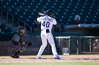 Surprise Saguaros outfielder Julio Pablo Martinez (40), of the Texas Rangers organization, at bat in front of catcher Daulton Varsho (8) during an Arizona Fall League game against the Salt River Rafters on October 9, 2018 at Surprise Stadium in Surprise, Arizona. Salt River defeated Surprise 10-8. (Zachary Lucy/Four Seam Images)