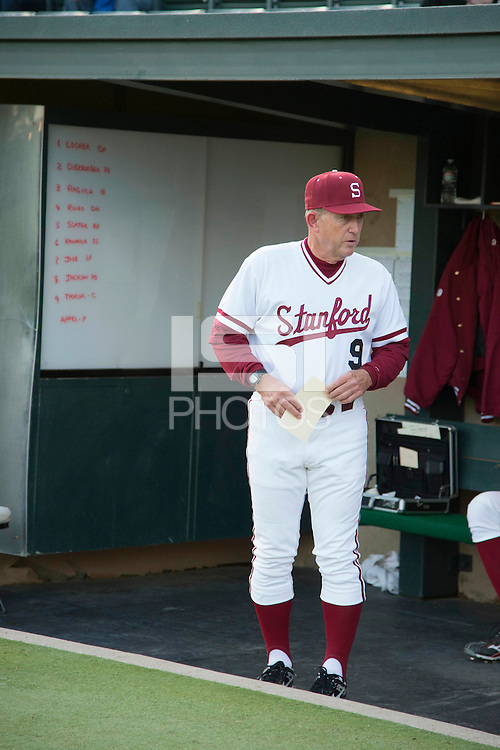 Stanford, CA - Friday, March 1, 2013: Stanford Cardinal head coach Mark Marquess stands in the dugout during the NCAA baseball game against the Texas Longhorns.