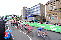 Picture by Allan McKenzie/SWpix.com - 15/05/2018 - Cycling - OVO Energy Tour Series Mens Race Round 2:Motherwell - The peloton races through Motherwell, OVO Energy, gantry, branding.