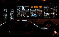 Aug. 6, 2008; Beijing, CHINA; A bus full of passengers drives alongside the Olympic Green. The Olympics begin at 8pm on August 8, 2008. Mandatory Credit: Mark J. Rebilas-