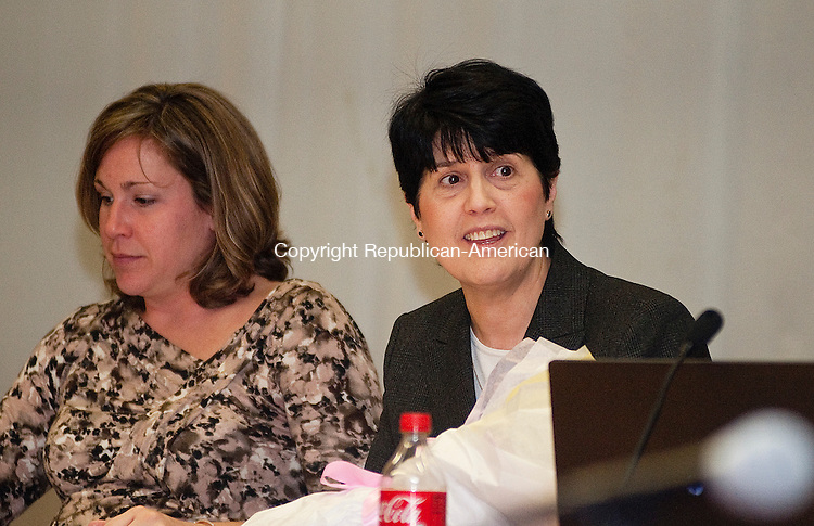 TORRINGTON. CT, 28 MARCH  2012-032812JS02-Torrington Superintendent of Schools Cheryl Kloczko, right, smiles as she in introduced as the school's new superintendent during a Board of Education meeting Wednesday at Torrington High School. .Jim Shannon Republican-American