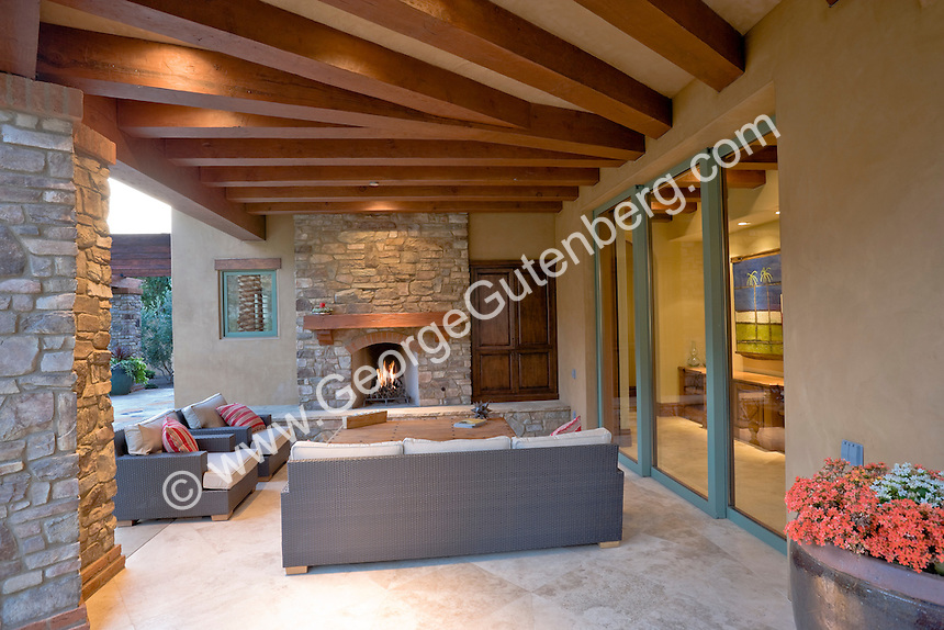 High Quality Outdoor Furnishing Are Shown By Fireplace Under Covered Patio