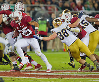 Stanford running back Tyler Gaffney (25) carries the ball as linebacker Joe Schmidt (38) attempts to tackle in the second quarter.