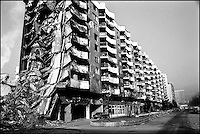 An apartment building near downtown Sarajevo. The war in the early 1990's destroyed most of the city. Sarajevo, Bosnia-Herzegovina, January 1999 &copy; Stephen Blake Farrington<br />