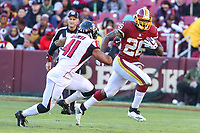 Landover, MD - November 4, 2018: Washington Redskins running back Adrian Peterson (26) runs past Atlanta Falcons defensive back Sharrod Neasman (41) during the  game between Atlanta Falcons and Washington Redskins at FedEx Field in Landover, MD.   (Photo by Elliott Brown/Media Images International)