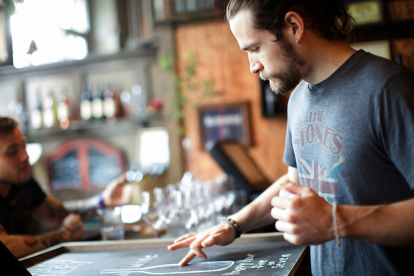 BROOKLYN, NY - JULY 2, 2013: Setting up signs for service at Brooklyn Winery in Williamsburg. CREDIT: Clay Williams.<br /> <br /> &copy; Clay Williams / http://claywilliamsphoto.com